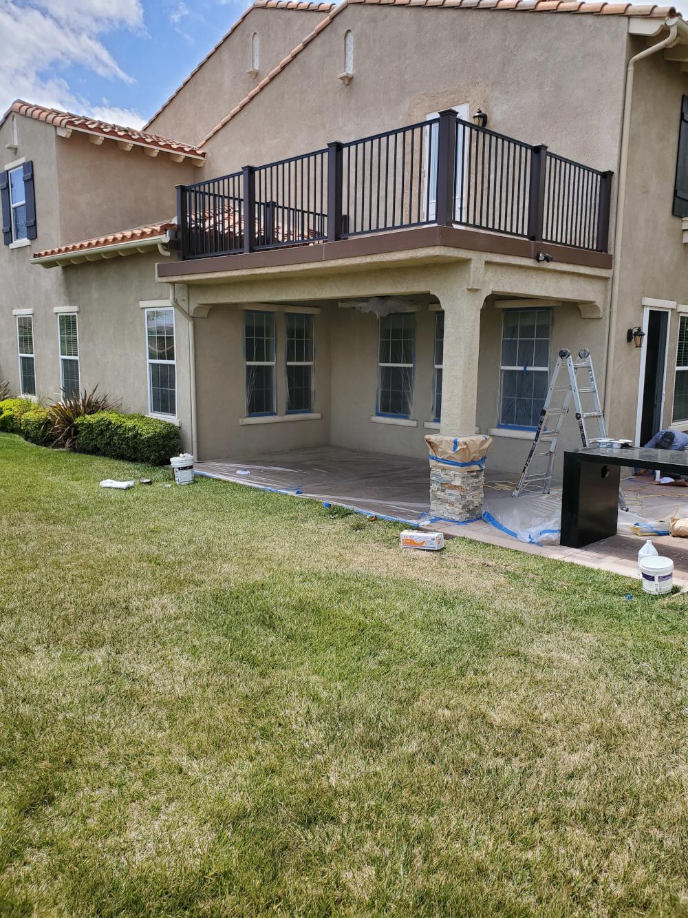 Custom patio cover with balcony